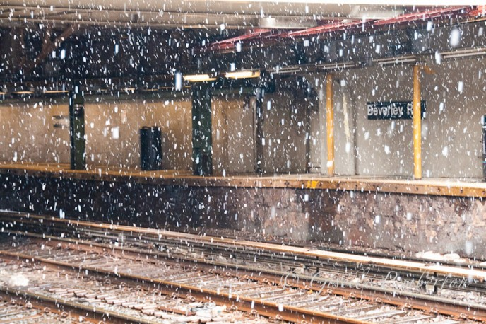 Snow falling on the tracks of the train station